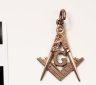 J64-176; Pendant, Square and Compasses with a G